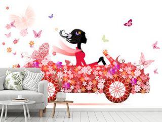 girl on a red flower car