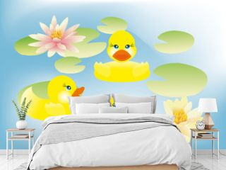Ducklings swimming in lake with lotus flowers