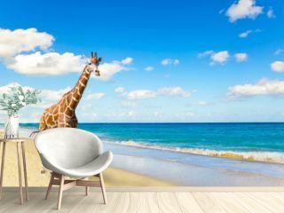 The giraffe runs on sand at seacoast
