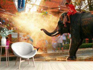 Elephant spraying water on people during Songkran festival, Bangkok