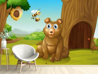A bear and a bee near a treehouse