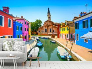 Venice landmark, Burano canal, houses, church and boats, Italy