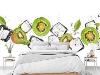 Kiwi slices with ice cubes, isolated on white background