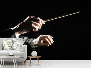Orchestra conductor hands baton