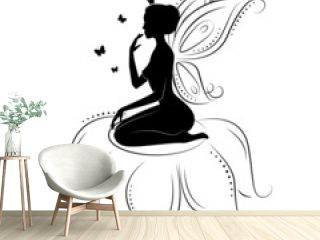 Silhouette of a beautiful fairy  on flowers.
