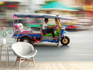 Tuktuk aus Thailand in Bewegungsunschärfe