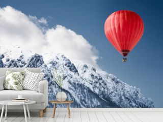 Balloon over winter landscape