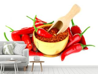 Milled red chili pepper in wooden bowl isolated on white