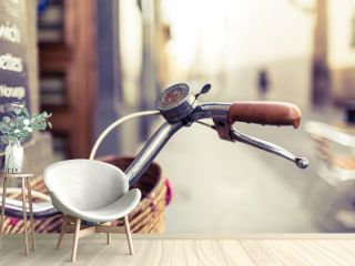 City bicycle handlebar and basket over blurred background