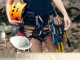 Woman standing with climbing equipment