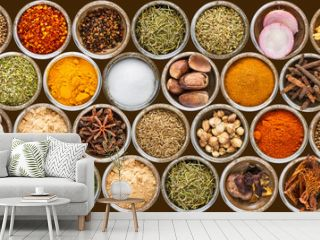 Spices and herbs in metal bowls background.
