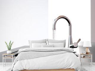 water flows from the kitchen tap to black kitchen sink