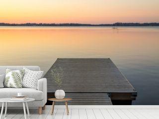 Wooden pier in the Scandinavian evening lake
