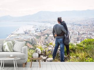 Couple holding each other, enjoying view above city of Palermo on top of Mount Pellegrino, Palermo, Sicily, Italy