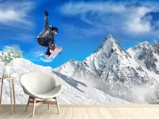 Extreme snowboarding man / Snowboarder jumping high in the air