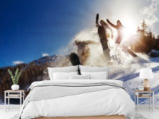 Powerful image of a snowboarder jumping over a kicker in the backcountry powder