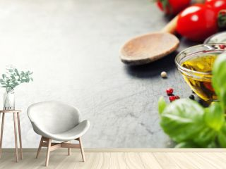 Wooden spoon and ingredients on old background