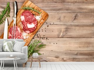 Raw beef steack meat with herbs and spices. Food background