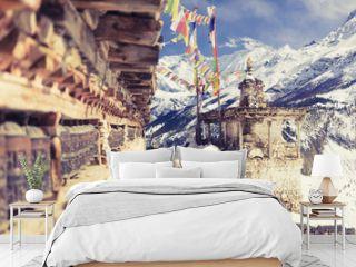 Prayer wheels in high Himalaya Mountains, Nepal village, tourism travel destination