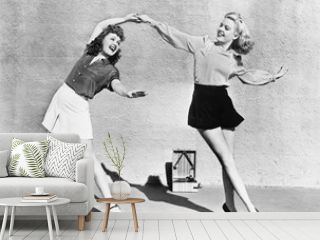 Two women dancing outside