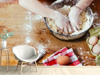 Girl in the kitchen playing with flour