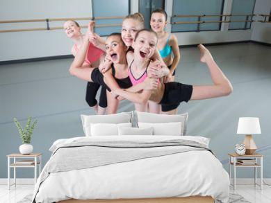 Group of young girls having fun in dance studio