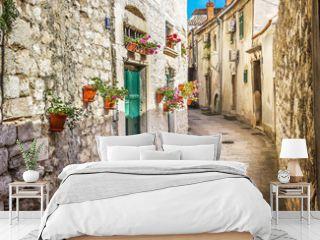 Narrow old street and yard in Sibenik city, Croatia, medieval zone
