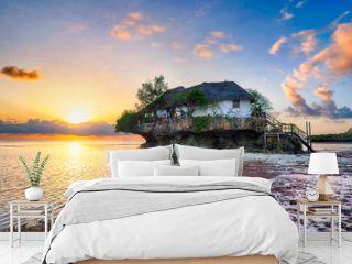 Restaurant the Rock at sunrise in the Indian ocean in Zanzibar,