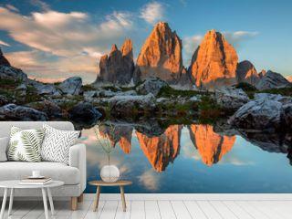 Tre Cime di Lavaredo with reflection in lake at sundown, Dolomit