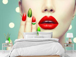 Watermelon nail art and makeup closeup over polka dots background