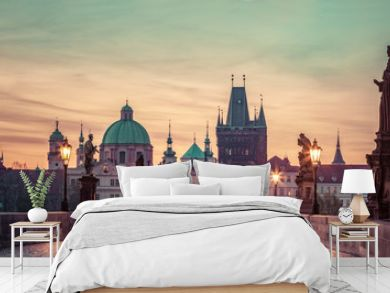 Charles Bridge at sunrise, Prague, Czech Republic. Dramatic statues and medieval towers.