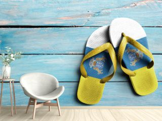 Thongs with flag of Canary Islands, on blue wooden boards