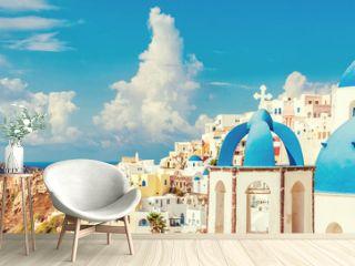 Three Domes church panoramic view of Santorini island, Oia village, Greece. Famous Europe travel european destination greek island. Horizon landscape banner crop for advertisement copyspace.
