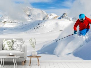 Skier skiing downhill in high mountains in fresh powder snow. Sa