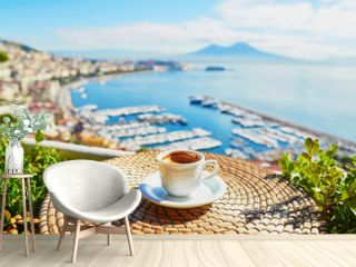 Cup of coffee with view on Vesuvius mount in Naples