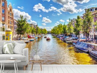 NETHERLANDS, AMSTERDAM - AUGUST 15, 2011: The view from the bridge over the canal in Amsterdam, cars, bikes and tourists who enjoy.  Sunny Day over the canal in Amsterdam, HDR Image.