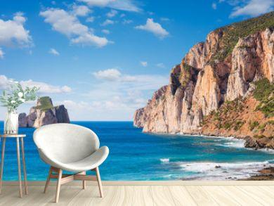 "High cliffs of Mediterranean coast, ""Pan di Zucchero"" stack rock in Masua, west coast of Sardinia, Italy"