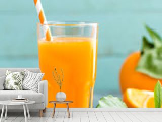 Orange juice in glass and fresh fruits with leaves on wooden background, vitamin drink or cocktail