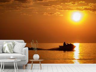 Silhouette jet ski in the sea landscape background