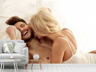 Cheerful young couple resting in the bedroom