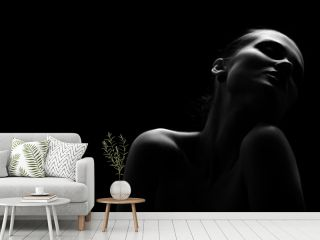 beautiful totpless woman with closed eyes on black background monochrome