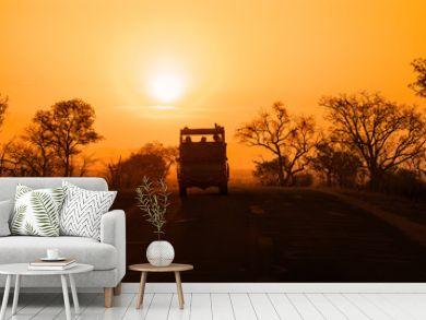 Safari vehicle at sunset