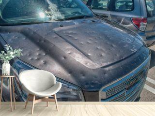 Hail damage to car