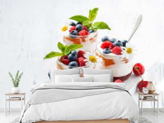 sweet dessert with jam, cream and fresh fruit on white background