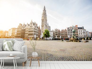 Morning view on the Grote Markt with beautiful buildings and church tower in Antwerpen city, Belgium