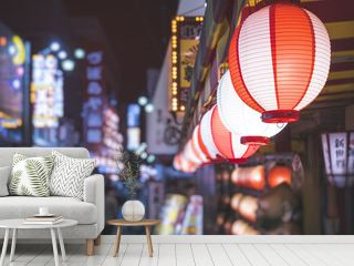 Lanterns light Japan nightlife Bar street district with blur people