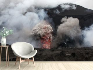 Volcanic erruption - Mount Yasur - Tanna Island Vanuatu. This volcano on the small tropical island is one of the most accesible in the world. It is a popular tourist destination in Vanuatu.