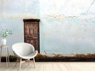 old vintage door with old vintage blue crack wall