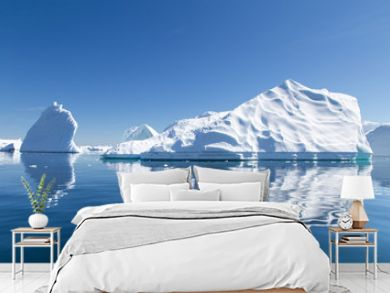 Icebergs reflect in the water in Pleneau Bay, Antarctica