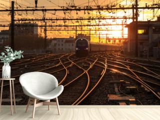 A train on the railroad tracks  during sunrise. Gare de Lyon-Perrache, Lyon, France.